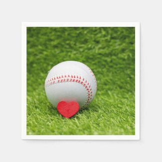 Baseball is on green grass with love wedding napkins