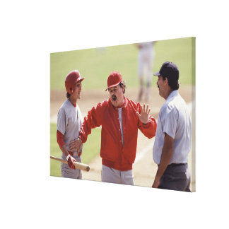 Baseball manager arguing with umpire and holding gallery wrap canvas