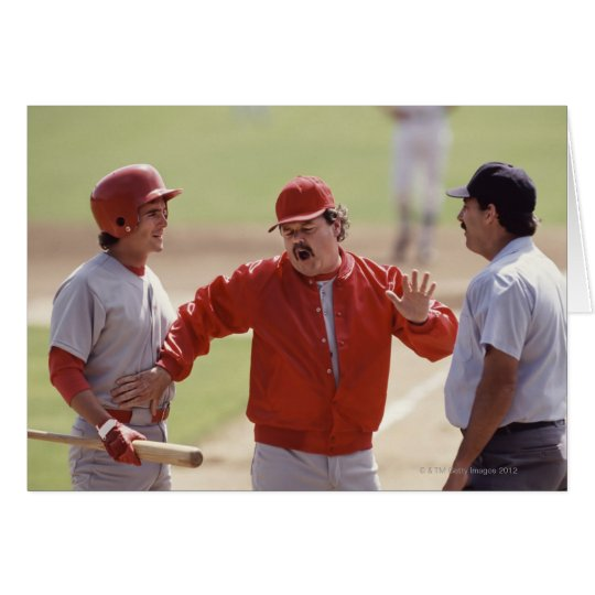 Baseball manager arguing with umpire and holding card