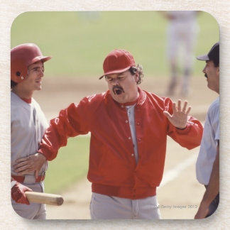 Baseball manager arguing with umpire and holding drink coaster