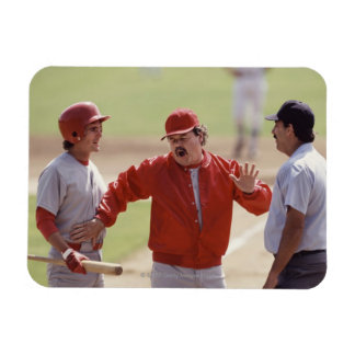 Baseball manager arguing with umpire and holding magnet