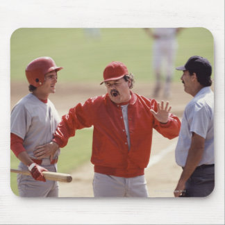 Baseball manager arguing with umpire and holding mouse pad