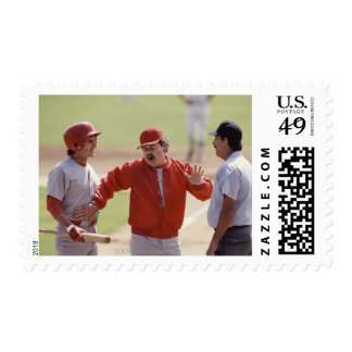 Baseball manager arguing with umpire and holding stamp
