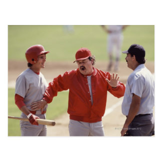 Baseball manager arguing with umpire and holding postcard