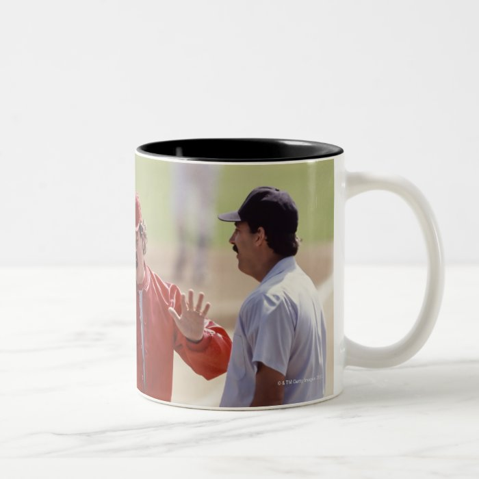 Baseball manager arguing with umpire and holding Two-Tone coffee mug