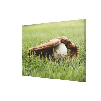 Baseball mitt with ball in grass canvas print