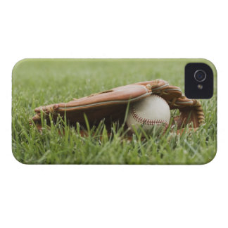Baseball mitt with ball in grass iPhone 4 case