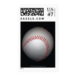 Baseball on black background, close-up postage