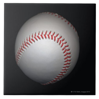 Baseball on black background, close-up ceramic tiles