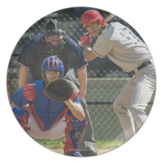 Baseball pitcher, batter and umpire in ready plate