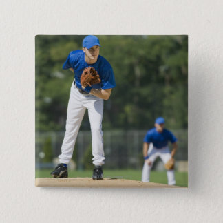 Baseball pitcher preparing to pitch ball button