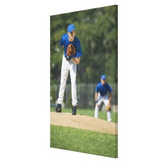 Baseball pitcher preparing to pitch ball canvas print