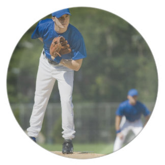 Baseball pitcher preparing to pitch ball dinner plate