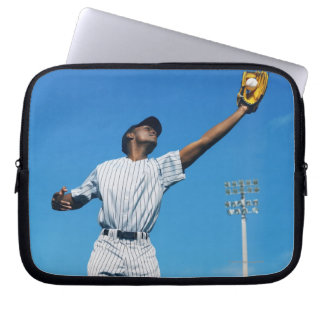 baseball player (16-20) catching ball in laptop sleeve