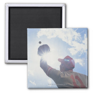 Baseball player catching ball with sun in his 2 inch square magnet