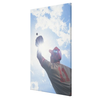 Baseball player catching ball with sun in his gallery wrap canvas