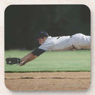 Baseball player in mid-air catching ball. drink coaster