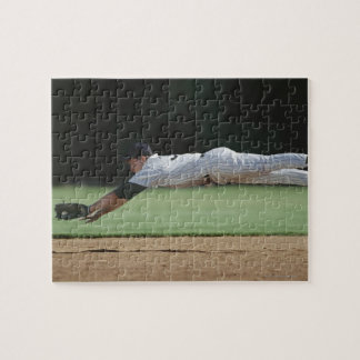 Baseball player in mid-air catching ball. jigsaw puzzle