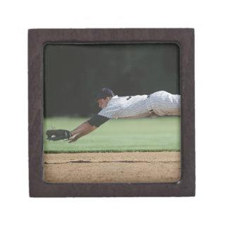 Baseball player in mid-air catching ball. keepsake box