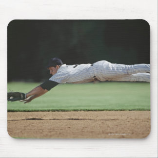 Baseball player in mid-air catching ball. mouse pad