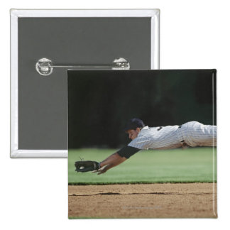 Baseball player in mid-air catching ball. pinback button