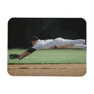 Baseball player in mid-air catching ball. rectangular photo magnet