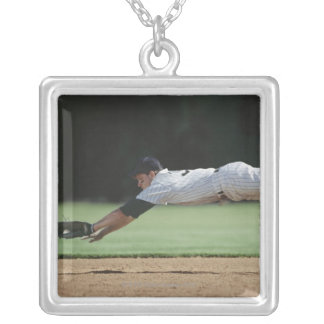 Baseball player in mid-air catching ball. silver plated necklace