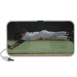 Baseball player in mid-air catching ball. iPod speaker