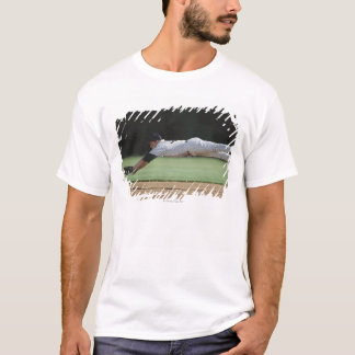 Baseball player in mid-air catching ball. T-Shirt
