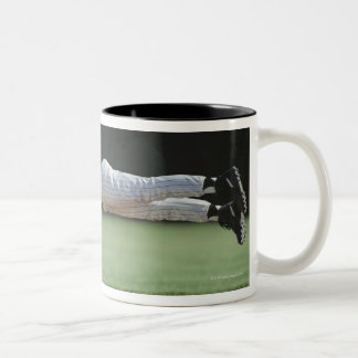 Baseball player in mid-air catching ball. Two-Tone coffee mug