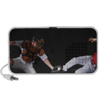 Baseball player sliding into a base travelling speaker