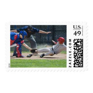 Baseball player sliding into home plate postage stamp