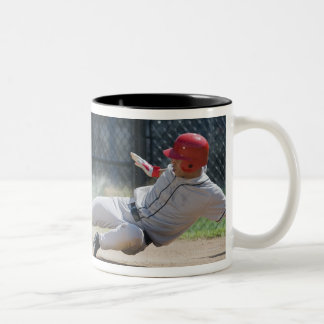 Baseball player sliding into home plate Two-Tone coffee mug