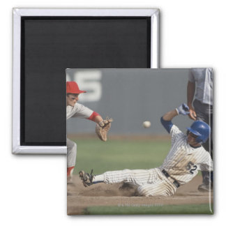 Baseball player sliding into third base with 2 inch square magnet