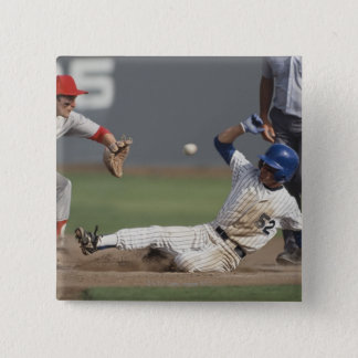 Baseball player sliding into third base with button