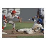 Baseball player sliding into third base with greeting card