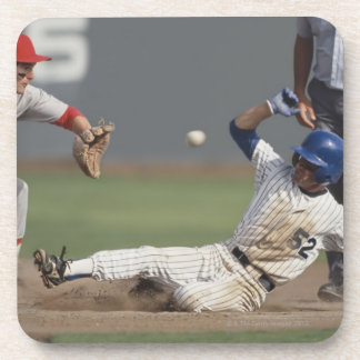 Baseball player sliding into third base with drink coaster