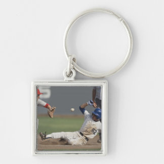 Baseball player sliding into third base with keychain