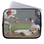 Baseball player sliding into third base with computer sleeves