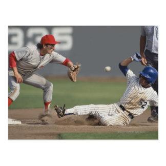 Baseball player sliding into third base with postcard