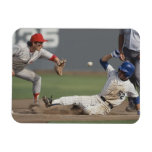 Baseball player sliding into third base with magnets