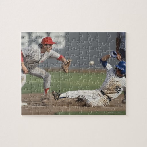 Baseball player sliding into third base with puzzle