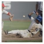 Baseball player sliding into third base with ceramic tiles