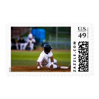 Baseball player sliding onto a base postage stamp