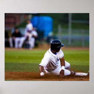 Baseball player sliding onto a base poster