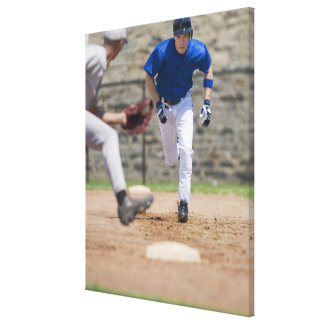 Baseball player trying to steal base canvas print