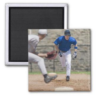 Baseball player trying to steal base fridge magnet