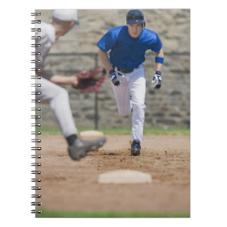 Baseball player trying to steal base notebook