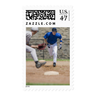 Baseball player trying to steal base postage