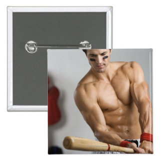 Baseball player with bare chest warming up with pinback button